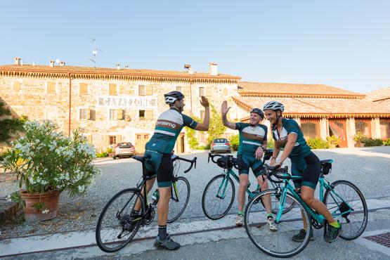 cyclists high five